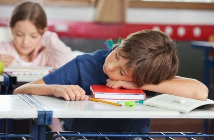 Sleeping child in the school